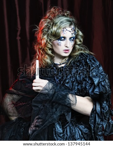 Gothic portrait of woman with candle. Halloween theme. - stock photo