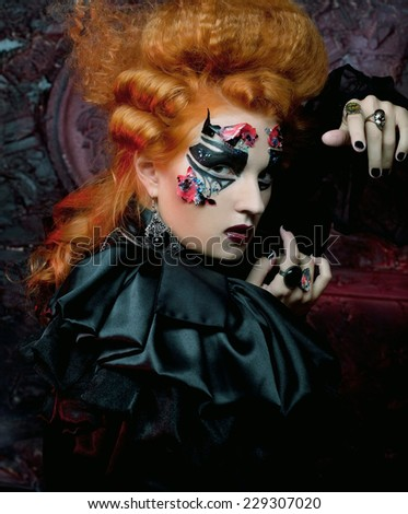 Gothic redhair witch. Dark woman.Halloween picture. - stock photo