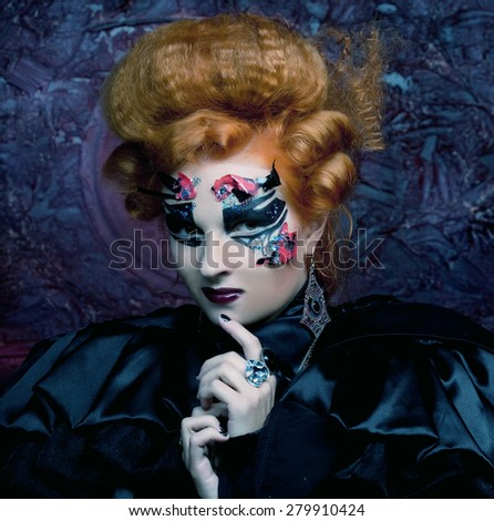 Gothic redhair witch.  Dark woman. Halloween picture. - stock photo
