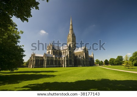 Gothic Salisbury Cathedral viewed across the green park