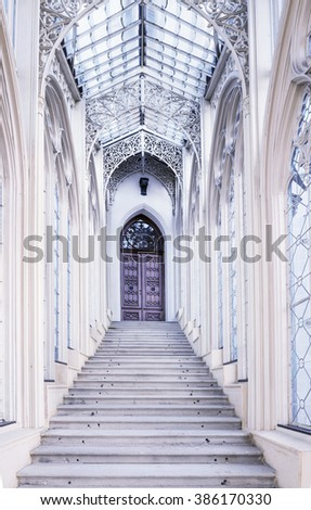 Gothic staircase with wrought-rich decorations in the Windows  in Castle Hluboka, Hluboka nad Vltavou. Czech Republic - stock photo