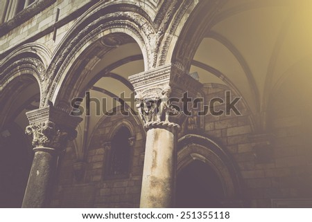 Gothic Stone Pillars in Retro Film Style - stock photo
