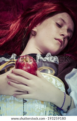 Gothic, Teen with a red apple lying, tale scene - stock photo