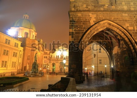 Gothic tower and church dome near the Charles bridge surrounded by fogg, Prague, Czech Republic - stock photo