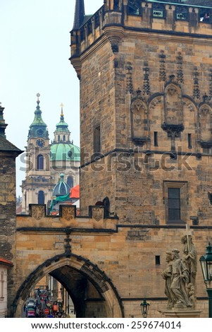 Gothic tower defending the Charles bridge and distant church towers, Prague, Czech Republic - stock photo