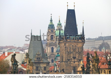 Gothic towers and distant church towers visible from the Charles bridge, Prague, Czech Republic - stock photo