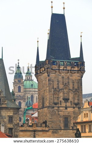Gothic towers under cloudy sky seen from the Charles Bridge, Prague, Czech Republic - stock photo