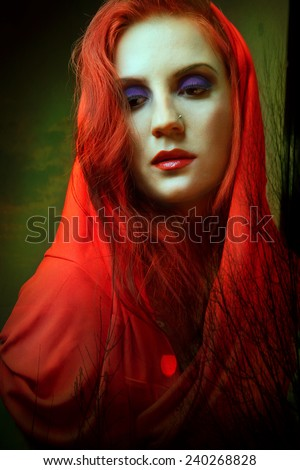 gothic woman in red hood. gothic - stock photo