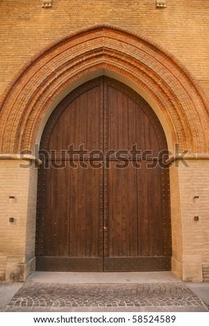 gothic wooden door at castle in italy - stock photo
