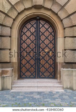 Gothic wooden old church door  - stock photo