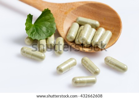 Gotu kola capsule in wooden spoon. Asiatic pennywort. - stock photo