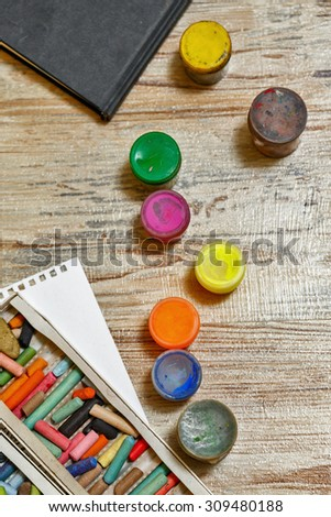 Gouache and pastel pencils close-up. Set of the young artist. Development of creative thought. - stock photo
