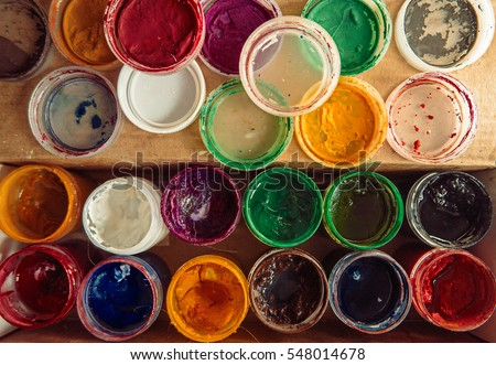 Gouache paint jars. Tools for creative work. Paintings Art Concept. Top view.