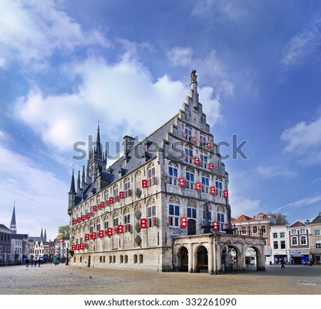 GOUDA-HOLLAND-OCT. 13, 2015. Ancient City Hall at Market Square. The city hall is built between 1448 and 1450, it is one of Gouda's top attractions and one of the oldest Gothic city halls in Holland. - stock photo