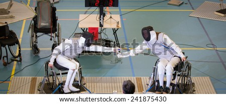 Gouda, NETHERLANDS -? OCTOBER 11 : Physically disabled athletes fencing in a wheelchair during an international tournament on OCTOBER 11, 2014 in GOUDA, NETHERLANDS - stock photo