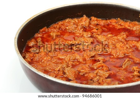 Goulash in Frying Pan. Isolated on a white background.