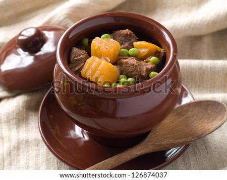 Goulash in pot with potayo and meat, selective focus