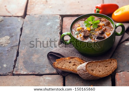 Goulash meat stew on stone background with copy space - stock photo