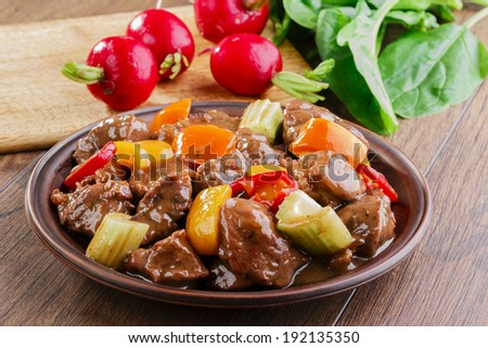 goulash meat with vegetable on the plate  - stock photo