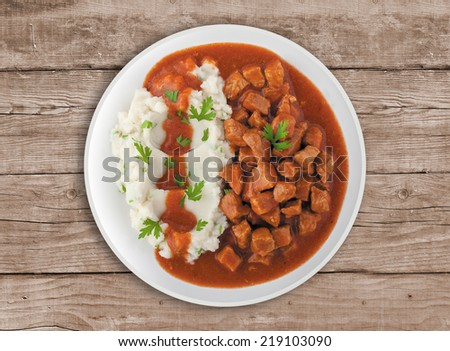 Goulash soup with potato. A Serbian traditional dish made from beef and pork - stock photo