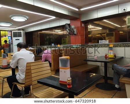 Goundgou, China 23 May 2017: Chinese cafeteria. Cafe interior design in China. Asian cafe. Chinese cafe. Chinese restaurant decorated in local style. Chinatown scene. Modern cafe in Chinese quarter