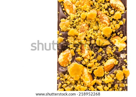 Gourmet almond toffee chocolate bar on a white background. - stock ...