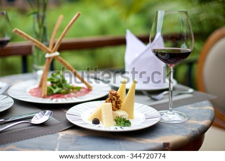 Gourmet Appetizers with various cheese and wine on a table - stock photo