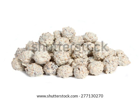 Gourmet assorted white truffles hand made by chocolatier on white background - stock photo