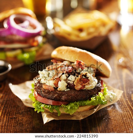 gourmet bacon and bleu cheese burgers with beer - stock photo