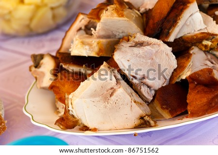 gourmet- baked-grilled slices of suckling pig - stock photo