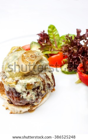 Gourmet beef tenderloin steak with onion, blue cheese , croutons and salad - stock photo