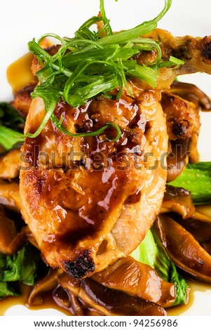 Gourmet bone in Chicken Cooked Asian Style.  Basted with a Teriyaki, soy glaze and garnished with green onions. - stock photo