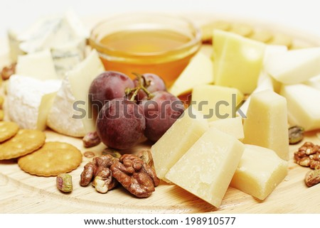 Gourmet cheese, set on wooden board