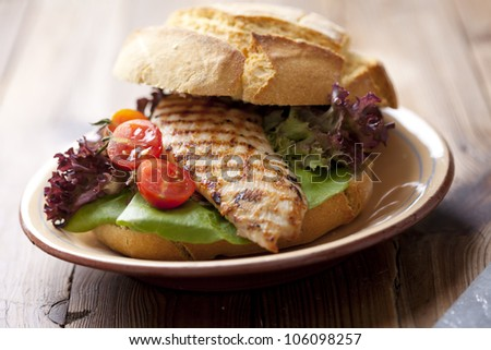 gourmet chicken sandwich with fresh and healthy ingredients