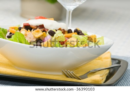 Gourmet chicken taco salad, with sparkling water