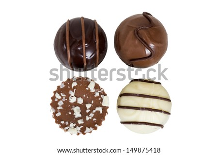 Gourmet chocolate truffles isolated on white background - stock photo