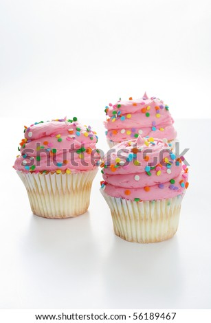 gourmet cupcakes isolated on white vertical - stock photo