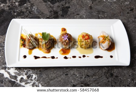 Gourmet Dim Sum on a black marble background - stock photo