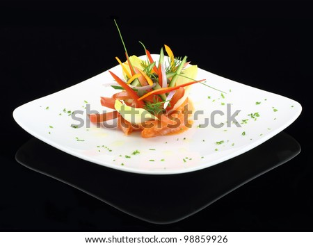Gourmet dish. Smoked salmon with vegetables