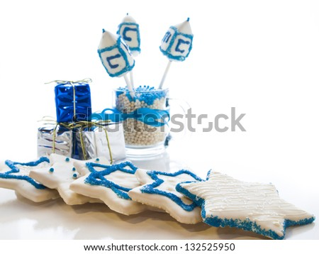 Gourmet dreidels decorated with white icing for Hanukkah. - stock photo