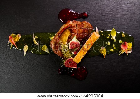 Gourmet duck dish with onion jam and figs - stock photo
