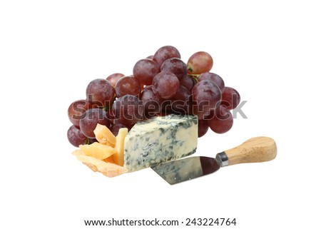 Gourmet eating - Pink grape cluster and two kinds of delicious cheese with reflection in knife blade isolated on white background - stock photo