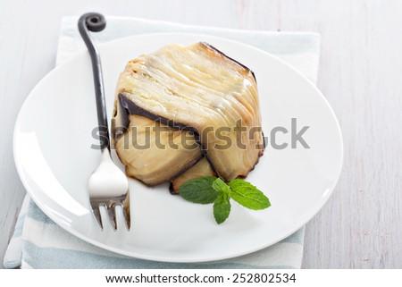 Gourmet eggplant pasta bake with bechamel sauce  - stock photo