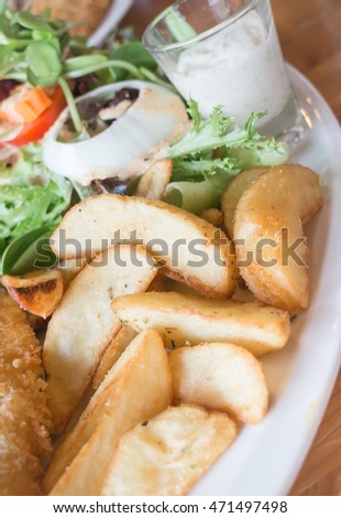 Gourmet fish and chips with salad, stock photo
