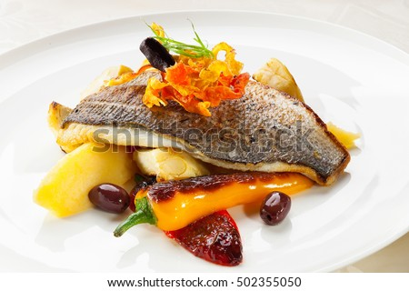 gourmet fish dish with Roasted vegetables