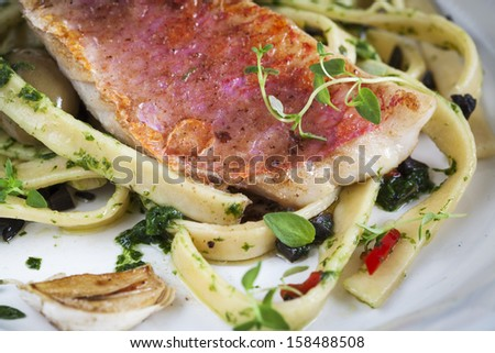 Gourmet fish food - stock photo