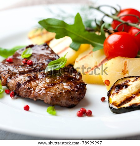 Gourmet grilled steak flavoured with pink pepper and basil - stock photo