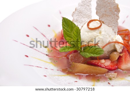 Gourmet ice cream with strawberries on plate isolated