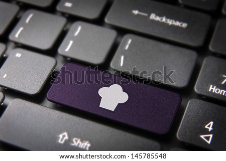 Gourmet key with Chef hat icon on laptop keyboard. Included clipping path, so you can easily edit it.