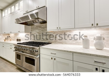 Gourmet kitchen features white shaker cabinets stock photo for White stock cabinets